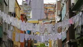 Linen drying on the street stock video