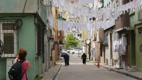 Linen drying on the street stock footage