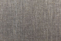 Linen fabric. A background texture image with natural colored linen fabric Stock Images