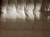 Linen fabric. Shadowed beige linen seat cover Royalty Free Stock Photography