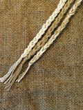 Linen fabric. Texture and three strings Stock Photos