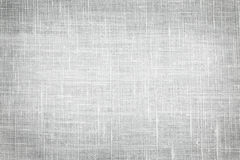 Linen fabric background. White linen woven fabric background or texture with dark vignette Stock Photos