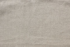 Linen fabric. Linen canvas fabric background, real natural material Stock Photos