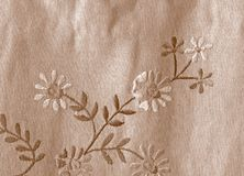 Linen fabric with flowers. Very old linen fabric texture with flowers Royalty Free Stock Photo
