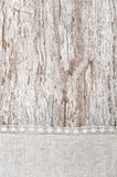 Linen fabric with lace on the old wooden background Stock Image