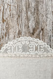 Linen fabric with lace on the old wooden background Stock Photo