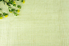 Linen fabric in natural colors with flowers Royalty Free Stock Image