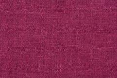 Linen fabric texture. Dark purple rough linen fabric texture close-up as background stock photography