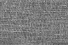 Linen fabric texture. Grey rough linen fabric texture close-up as background royalty free stock photo