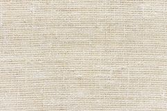 Linen fabric texture. Natural colored rough linen fabric texture close-up as background royalty free stock photo