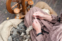 Linen floss. Woman producing a linen floss traditional way. Shallow DOF Royalty Free Stock Image