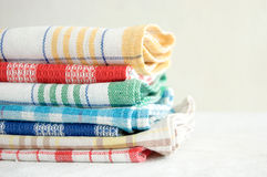 Linen kitchen towels. Pile of linen kitchen towels on a white background Royalty Free Stock Photos