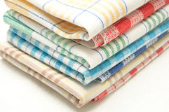 Linen kitchen towels. Pile of linen kitchen towels on a white background Stock Photos
