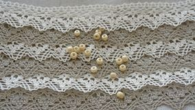 Linen lace with beads royalty free stock photos
