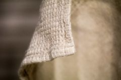 Linen material is curved. towel linen hanging and natural curves. grey natural color of the fabric stock photos