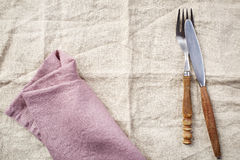 Linen napkin background with fork and knife Royalty Free Stock Photos