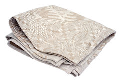 Linen napkin. Beige linen napkin isolated on white, top side view Stock Image