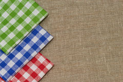 Linen napkin. Blue green red  linen napkin on a gray fabric Royalty Free Stock Photos