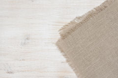 Linen napkin fragment on wood with copy space Stock Images