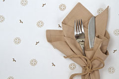Linen napkin with knife and fork Stock Images