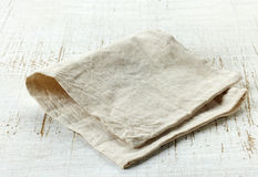 Linen napkin. On old wooden table Stock Image