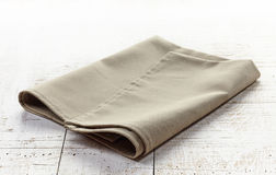 Linen napkin on wooden table Stock Images