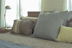 Linen pillows in difference size on bed in modern japanese style bedroom. Interior Royalty Free Stock Photos
