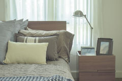 Linen pillows in difference size on bed in modern japanese style bedroom interior. Linen pillows in difference size on bed in modern japanese style bedroom Royalty Free Stock Image
