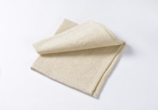 Linen place mat. Small folded linen place mat Royalty Free Stock Images