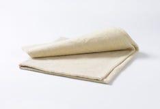 Linen place mat. Small folded linen place mat Stock Photo
