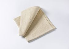 Linen place mat. Small folded linen place mat Royalty Free Stock Photos