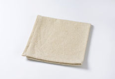 Linen place mat. Small folded linen place mat Royalty Free Stock Photo