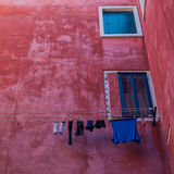 Linen on a rope. Colorful photo of traditional venice streets in Italy Stock Photo