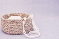 Linen rustic crochet box with white crochet lace. Natural crochet textile tutorial pattern. Thick ribbon cotton yarn stock photography