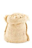 A linen sack filled by avenaceous flakes Stock Photo