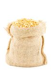 A linen sack filled by the crushed dry yellow peas Royalty Free Stock Images