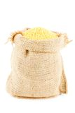 A linen sack filled by yellow millet Royalty Free Stock Image