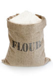 Linen sack with flour. Linen sack full of flour isolated on white background Royalty Free Stock Photo