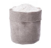 Linen sack full of flour on white background Royalty Free Stock Image
