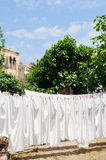 Linen sheets drying on a rope in Cunda Alibey Stock Image
