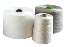 Linen and silk yarn bobbins Stock Images