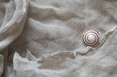 Linen with snail shell Stock Photography