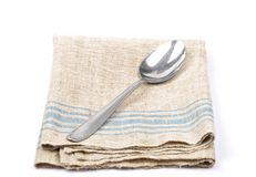Linen and spoon Royalty Free Stock Image