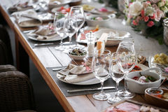 Linen textile. Decorated table, a plate of neatly arranged napkin, fork and knife. Royalty Free Stock Photo