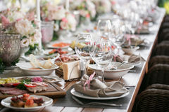 Linen textile. Decorated table, a plate of neatly arranged napkin, fork and knife. selective focus Royalty Free Stock Images