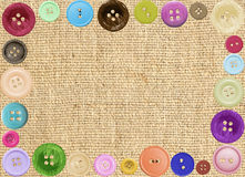 Linen texture background with colorful buttons Stock Photography