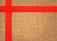 Linen texture background with red ribbon. Linen texture with red ribbon Royalty Free Stock Photos