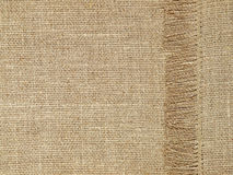 Linen texture pattern with fringe as background. Royalty Free Stock Photo