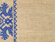 Linen texture with russian traditional ornament.Background. Royalty Free Stock Photo