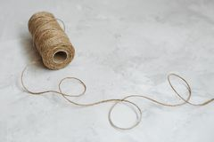 Linen thread spool on a textured gray background royalty free stock image